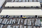 Nederland, Zuid-Holland, Rotterdam, 10-06-2015; Botlek terminal van C. Steinweg Handelsveem B.V., gelegen aan Het Scheur. Steinweg verzorgt opslag, expeditie en stuwadoren van onder andere metalen en andere handelsgoederen.<br /> Steinweg  warehousing services and stevedoring of metals and other commodities <br /> luchtfoto (toeslag op standard tarieven);<br /> aerial photo (additional fee required);<br /> copyright foto/photo Siebe Swart