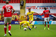 AFC Wimbledon midfielder Anthony Hartigan (8) about to pass the ball during the EFL Sky Bet League 1 match between Charlton Athletic and AFC Wimbledon at The Valley, London, England on 12 December 2020.