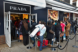© Licensed to London News Pictures.  17/12/2011. Bicester, UK. Shoppers queue outside the Prada store at Bicester Village today (Sat) on what is traditionally the busiest shopping day in the run up to Christmas.  Photo credit :  Cliff Hide/LNP