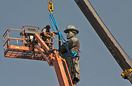 Friday, May 19, 2017, New Orleans, LA, Masked workers prepare a Confederate statue of  General Robert E. Lee for removal from Lee Circle. It was the last of four Confederate-era monuments to be removed after a proposal by Mayor Mitch Landrieu to remove the monuments was approved by the city council in 2015.