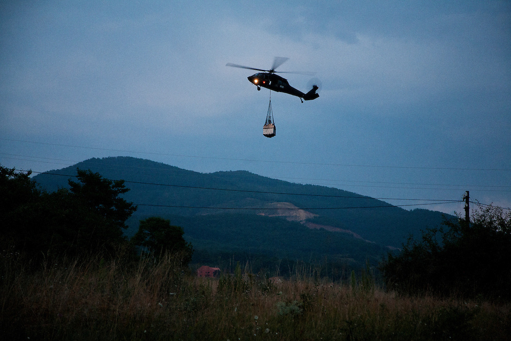 """A KFOR Blackhawk helicopter flies in supplies to the Jarinje checkpoint in Northern Kosovo during the Serbian blockade of the main supply route...KFOR-occupied """"Gate 1"""" on the Serbian-Kosovo border, also known at Jarinje...Border crisis, July 2011"""