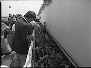 Irish Soccer Team Welcomed Home.   (R81)..1988..19.06.1988..06.19.1988..19th June 1988..After their great success in Germany in Euro 88, the Irish soccer team had a triumphant homecoming. An Taoiseach, Charles Haughey TD and his government were to the forefront of the welcome. Thousands of fans thronged the airport and all the approach roads in the hope of seeing the team. The full squad is as follows..1.GK.Packie Bonner. Celtic.2.DF.Chris Morris. Celtic.3.DF.Chris Hughton  Tottenham Hotspur.4.DF.Mick McCarthy. Celtic.5.DF.Kevin Moran. Manchester United.6.MF.Ronnie Whelan. Liverpool.7.MF.Paul McGrath. Manchester United.8.MF.Ray Houghton. Liverpool.9.FW.John Aldridge. Liverpool.10.FW.Frank Stapleton Derby County.11.MF.Tony Galvin. Sheffield Wednesday.12.FW.Tony Cascarino. Millwall.13.MF.Liam O'Brien. Manchester United.14.FW.David Kelly. Walsall.15.MF.Kevin Sheedy. Everton.16.GK.Gerry Peyton. Bournemouth.17.FW.John Byrne. Le Havre.18.FW.John Sheridan. Leeds United.19.DF.John Anderson. Newcastle United.20.FW.Niall Quinn. Arsenal..Picture shows the crowd thronging the foothpath alongside the bus.