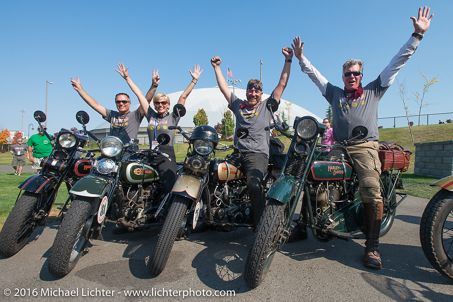 """Team Vino with Scott Jacobs, Sharon Jacobs, Robert Gustavsson (""""Big Swede"""") and Dean Bordigioni celebrate after crossing the finish line at the end of Stage 16 (142 miles) of the Motorcycle Cannonball Cross-Country Endurance Run, which on this day ran from Yakima to Tacoma, WA, USA. Sunday, September 21, 2014.  Photography ©2014 Michael Lichter."""