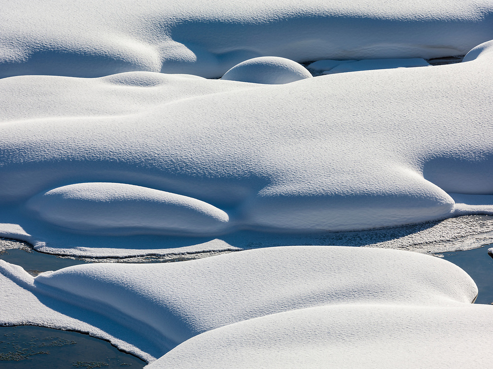 Licensing - Open Edition Prints Snow patterns along the edge of the Snake River near Jackson Hole, Wyoming