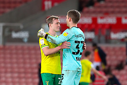 Oliver Skipp and Michael McGovern of Norwich City embrace after the final whistle - Mandatory by-line: Nick Browning/JMP - 24/11/2020 - FOOTBALL - Bet365 Stadium - Stoke-on-Trent, England - Stoke City v Norwich City - Sky Bet Championship