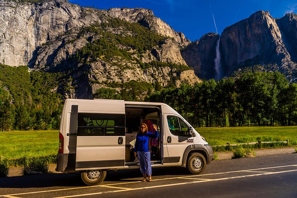 Visiting Yosemite National Park during a road trip with a camper van, California USA.