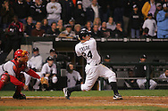 CHICAGO - OCTOBER 12:   Joe Crede #24 of the Chicago White Sox doubles to left field, driving in Pablo Ozuna with the winning run with two out in the bottom of the 9th inning during Game 2 of the American League Championship Series against the Los Angeles Angels of Anahiem at U.S. Cellular Field on October 12, 2005 in Chicago, Illinois.   The White Sox defeated the Angels 2-1.
