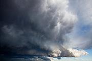 Cumulonimbus clouds billow along the Front Range, Colorado.