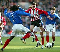 Photograph: Scott Heavey.<br />Southampton v Portsmouth. FA Barclaycard Premiership. 21/12/2003.<br />Marian Pahars skips through the Pompey defence
