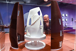 """© Licensed to London News Pictures. 17/10/2019. LONDON, UK. A staff member views a model of """"Marsha's two shell-design"""", 2019, by AI Spacefactory, a 3D printed habitat. Preview of """"Moving to Mars"""" at the Design Museum. The exhibition explores how sending humans to Mars is a frontier for science as well as design and features over 200 exhibits from NASA, the European Space Agency together with new commissions.  The show is open 18 October to 23 February 2020.  Photo credit: Stephen Chung/LNP"""