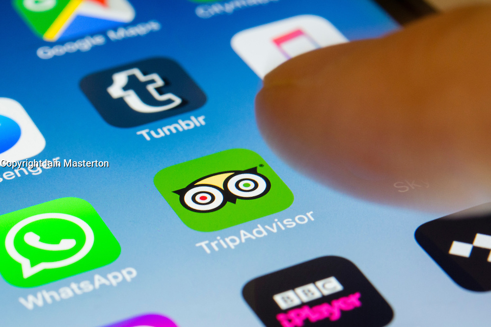 Tripadvisor travel booking and reviews site app close up on iPhone smart phone screen