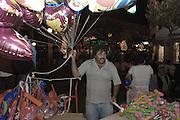 A baloon seller during the São João Party