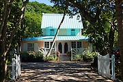 Quaint clapboard winter cottage home with sundeck and palm trees  on Captiva Island in Florida, USA