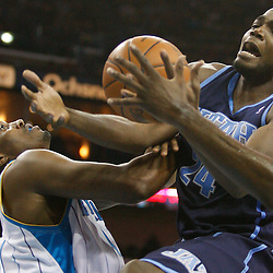 Apr 09, 2010; New Orleans, LA, USA; Utah Jazz forward Paul Millsap (24) loses possession of the ball as he collides with New Orleans Hornets forward James Posey (41) during the second half at the New Orleans Arena. The Jazz defeated the Hornets 114-103. Mandatory Credit: Derick E. Hingle-US PRESSWIRE