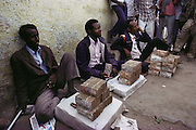 Money changers with stacks of old Somali shillings.  Old Somali shillings as seen here are still used in Somalia. The government hasn't printed new money yet. Five U.S. dollars equal a 3-inch stack of 100 shilling notes. In Hargeisa, Somaliland. Somaliland is the breakaway republic in northern Somalia that declared independence in 1991 after 50,000 died in civil war.