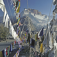CHINA, TIBET, LHASA. Potala Palace, former abode of Dalai Lama & site of many revered Tibetan Buddhist temples. Prayer flags foreground (shown here in 1986) are now gone & modern concrete buildings clutter the scene.