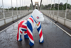 """© Licensed to London News Pictures; 06/08/2021; Bristol, UK. A model gorilla called """"Jackorilla"""" and wearing a replica Tokyo 2020 Olympic gold medal is placed at the Clifton Suspension Bridge to say a great big thank you to Team GB for their excellent efforts in brining the medals back home from the Tokyo 2020 Olympic Games. The gorilla's union jack colours were designed and painted by Tony Miles, aka Smiley Miley from the Radio One Roadshow. Tony organised a fireworks display on the Clifton Suspension Bridge for the 2012 Olympic torch relay as it passed across the bridge. Photo credit: Simon Chapman/LNP."""