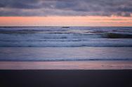 Waves reflecting sunset colors - Long Beach, WA