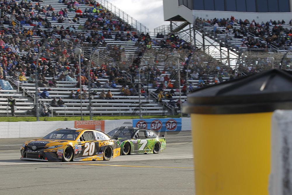 October 29, 2017 - Martinsville, Virginia, USA: Matt Kenseth (20) and Hermie Sadler (7) battle for position during the First Data 500 at Martinsville Speedway in Martinsville, Virginia.