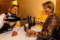 Serving Cava (Spanish sparkling wine) at a wedding reception, Trysil, Norway.