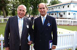 Leftt to right, joint chairmen of the evening BRIGADIER DICK WEBSTER and MR NIGEL CLARK at the Royal Windsor Charity Race Evening in aid of the Great Ormond Street Hospital Children's Charity held at Windsor Racecourse, Berkshire on 5th July 2004.