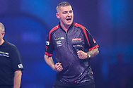 Nathan Aspinall hits a double and wins a leg and celebrates during the PDC William Hill World Darts Championship Semi-Final at Alexandra Palace, London, United Kingdom on 30 December 2019.