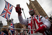 Leave means leave pro Brexit anti Europe demonstrator wearing patrioric Union Jack flags in Westminster opposite Parliament on the day MPs vote on EU withdrawal deal amendments on 29th January 2019 in London, England, United Kingdom.