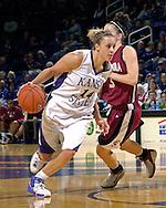 Kansas State guard Claire Coggins (14) drives around Santa Clara guard Chandice Cronk (3) in the second half at Bramlage Coliseum in Manhattan, Kansas, December 15, 2006.  K-State defeated Santa Clara 76-52.<br />