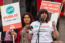London, UK. 1st May, 2019. Rehana Azam, National Secretary of the GMB trade union, addresses representatives of trade unions and socialist and communist parties from many different countries attending the annual May Day rally in Trafalgar Square to mark International Workers' Day.