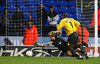 Photo: Paul Greenwood.<br />Bolton Wanderers v Arsenal. The FA Cup. 14/02/2007. Arsenal's Julio Baptista, right, goes around Bolton keeper Jussi Jaaskelainen for Arsenal's third to be scored by Adebayor (unseen)