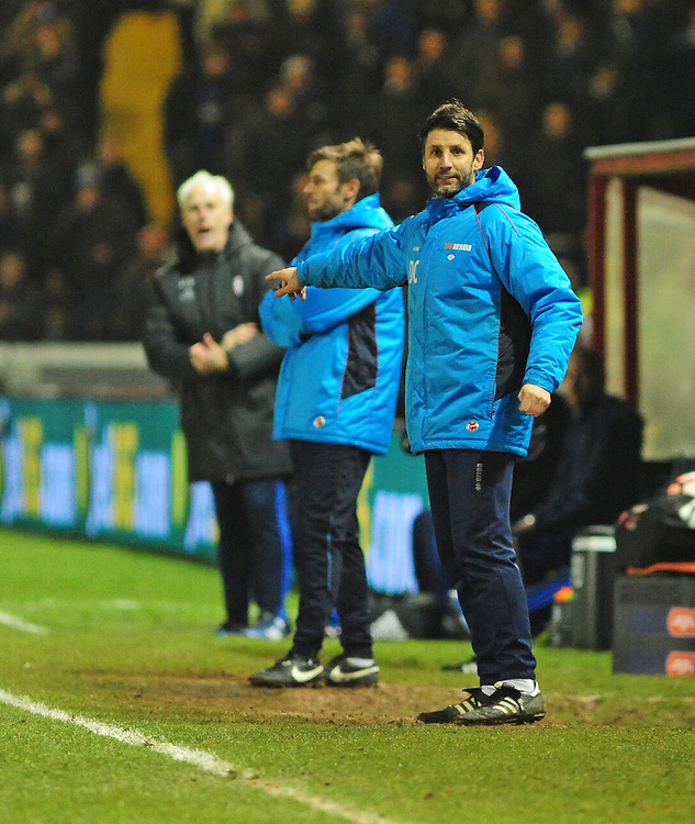 Lincoln City manager Danny Cowley shouts instructions to his team from the dug-out<br /> <br /> Photographer Andrew Vaughan/CameraSport<br /> <br /> Emirates FA Cup Third Round Replay - Lincoln City v Ipswich Town - Tuesday 17th January 2017 - Sincil Bank - Lincoln<br />  <br /> World Copyright © 2017 CameraSport. All rights reserved. 43 Linden Ave. Countesthorpe. Leicester. England. LE8 5PG - Tel: +44 (0) 116 277 4147 - admin@camerasport.com - www.camerasport.com