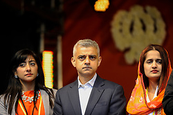 © Licensed to London News Pictures. 28/04/2018. LONDON, UK.  Sadiq Khan, Mayor of London, on stage with members of the Vaisakhi Organising Committee at Vaisakhi in Trafalgar Square.  For Sikhs and Punjabis, the festival celebrates the spring harvest and commemorates the founding of the Khalsa community over 300 years ago.  Photo credit: Stephen Chung/LNP