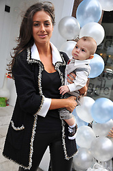 SASKIA BOXFORD and her son RIVER at a Cupcake & Tea Party to celebrate the launch of the C de C children's boutique at 133 Fulham Road, London SW3 on 11th October 2011.
