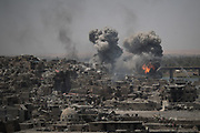 """Airstrikes continue to target Islamic State positions on the edge of the Old City a day after Iraq's prime minister declared """"total victory"""" in Mosul, Iraq, Tuesday, July 11, 2017. (AP Photo/Felipe Dana)"""