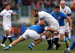 England's Chris Robshaw gets tackled by Italy's Tommaso Castello during the NatWest 6 Nations match at the Stadio Olimpico, Rome.