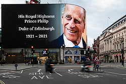 © Licensed to London News Pictures. 09/04/2021. LONDON, UK. The digital screen in Piccadilly Circus displays a tribute to Prince Philip, aged 99, whose death was announced by Buckingham Palace.  Photo credit: Stephen Chung/LNP