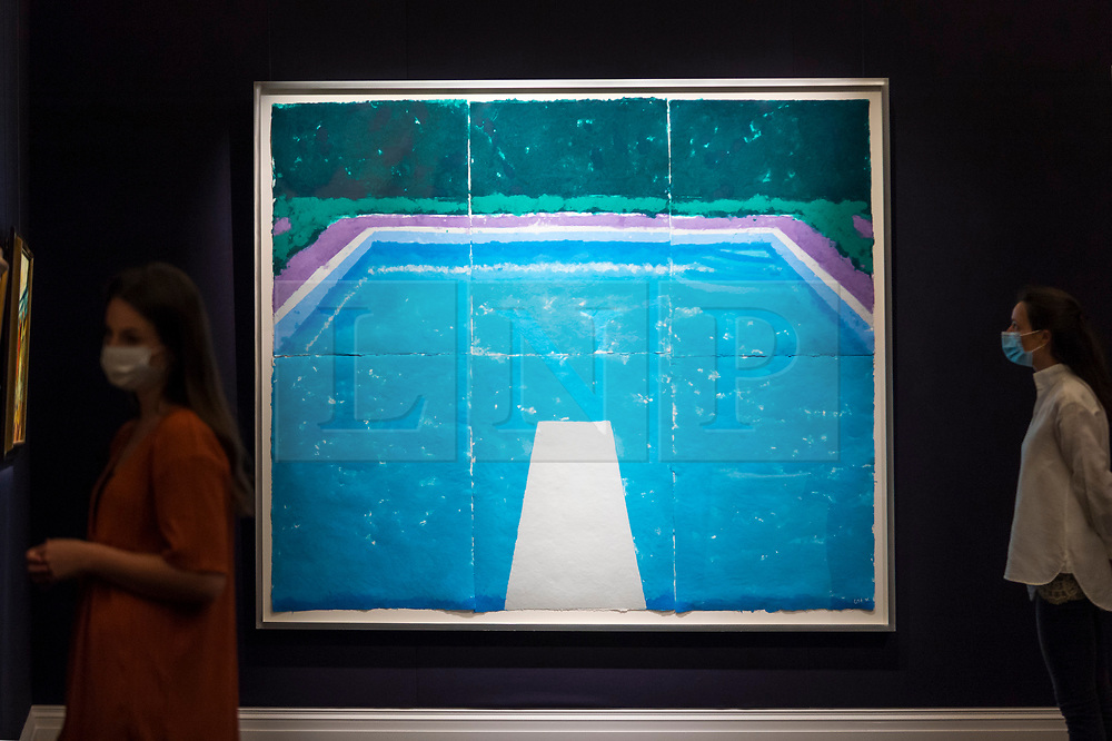 """© Licensed to London News Pictures. 23/07/2020. LONDON, UK. Staff members next to """"Pool on a Cloudy Day with Rain (Paper Pool 22) (1978) by David Hockney, estimate: £4-6 million. Preview of works on display at Sotheby's London ahead of a one-off auction on July 28.  Titled 'Rembrandt to Richter', the sale will offer the very best from Old Masters, Impressionist & Modern Art, Modern & Post-War British Art and Contemporary Art.  The exhibition is open to the public at Sotheby's New Bond Street galleries until July 28. [Image embargoed for release until 9am BST 24 July 2020].  Photo credit: Stephen Chung/LNP"""