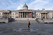 With very few people out and about the scene at Trafalgar Square and the National Gallery is one of empty desolation as the national coronavirus lockdown three continues on 28th January 2021 in London, United Kingdom. Following the surge in cases over the Winter including a new UK variant of Covid-19, this nationwide lockdown advises all citizens to follow the message to stay at home, protect the NHS and save lives.