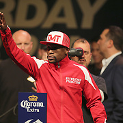"""Floyd Mayweather Jr. walks onto the stage during the official weigh-ins for the Mayweather versus Maidana boxing match slated as """"The Moment"""", at the MGM Grand hotel on Friday, May 2, 2014 in Las Vegas, Nevada.  (AP Photo/Alex Menendez)"""