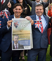 © Licensed to London News Pictures. 24/06/2016. London, UK.  ANDY WIGMORE and UKIP donor ARRON BANKS celebrating in Westminster on the day that the UK voted to leave the EU in a referendum. The pair have been accused of colluding with Russian officials over the 2016 Brexit referendum. Photo credit: Ben Cawthra/LNP