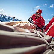 Leg 02, Lisbon to Cape Town, day 13, on board MAPFRE, Pablo Arrarte packing a sail after a pilling. Photo by Ugo Fonolla/Volvo Ocean Race. 17 November, 2017.