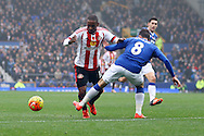 Jermain Defoe of Sunderland is tackled by Bryan Oviedo of Everton. Barclays Premier League match, Everton v Sunderland at Goodison Park in Liverpool on Sunday 1st November 2015.<br /> pic by Chris Stading, Andrew Orchard sports photography.