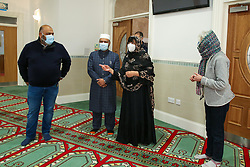 © Licensed to London News Pictures. 01/12/2020. London, UK. Owner of Foodhall (L), IMAM ABDUL KADIR (2nd L), BIBI KHAN (2nd R) and a member of Gospel Church (R) attend London Islamic Cultural Society, also known as Wightman Road Mosque in north London as they donate halal food to the FoodBank at the Gospel Church. Muslim families visiting the foodbank during the COVID-19 lockdowns have appealed for help with food items, especially halal food. Photo credit: Dinendra Haria/LNP