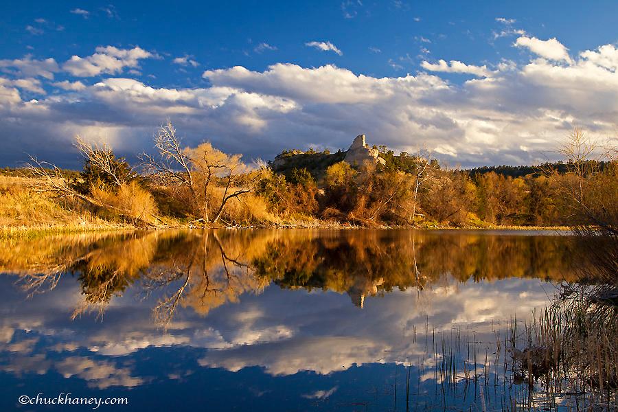 Pond reflects hills and bluffs at the Buffalo Creek WMA near Scottsbluff, Nebraska, USA