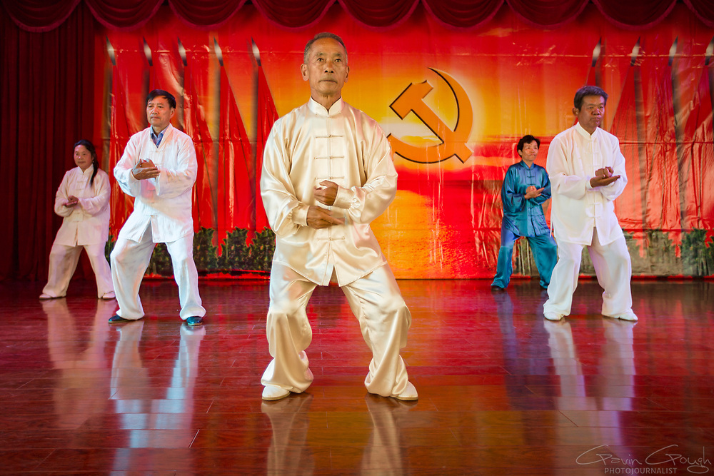 Students at a University of the Third Age (U3A) perform traditional Tai Chi moves during a performance. Universities provide learning and social classes for retired and elderly citizens.