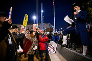"""SAN FRANCISCO, CA - DECEMBER 17: Event organizer Steven Rapport addresses the crowd while dressed as founding father Alexander Hamilton during demonstrations in part of a national impeachment rally, at the San Francisco Federal Building in San Francisco, California on December 17, 2019. Protesters around the nation participated in """"Nobody is Above the Law"""" rallies on the eve of a historic Trump impeachment vote in the United States House of Representatives. The crowd size at the San Francisco event is approximated in the several hundreds. (Photo by Philip Pacheco/AFP)"""