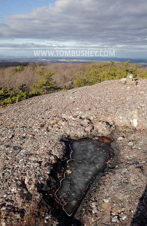 Mountainville, New York - Ice covers water in a depression in the rocks on Schunnemunk Mountain on  Nov. 28, 2010. The photograph was taken on the Jessup Trail.