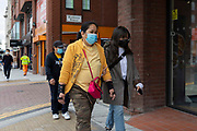 Two women wearing face masks in public to prevent the spread of Covid-19 on 18th August, 2021 in Leeds, United Kingdom. The UKs Office for National Statistics ONS has announced the number of coronavirus-related deaths in England and Wales is the highest since March.