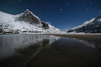 Night winter mountain reflection on Bunes beach, Moskenesøy, Lofoten Islands, Norway