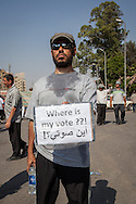 A pro-Morsi demonstrator holds a sign referring to his democratically elected leader, Mohammed Morsi.